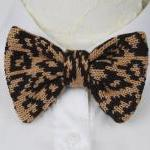 Knitted bow tie in leopard pattern